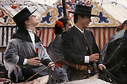 Drinking sherry on horseback and ignoring the rain at the April Fair, Seville, Spain.