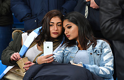 Manchester City fans take a selfie in the stands