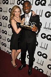 KYLIE MINOGUE and Solo Artist of the Year TINIE TEMPAH at the GQ Men of the Year 2011 Awards dinner held at The Royal Opera House, Covent Garden, London on 6th September 2011.