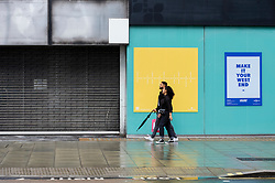 © Licensed to London News Pictures. 30/07/2021. LONDON, UK.  People pass an empty store on Oxford Street. According to a report from the British Retail Consortium (BRC) and Local Data Company, one in seven shops across Britain is empty as retailers continue to suffer the effects of the Covid pandemic on footfall and customers move to online shopping.  There is a sharp divide between the south of England, including London, with lower vacancy rates compared to the north of the country.  Photo credit: Stephen Chung/LNP