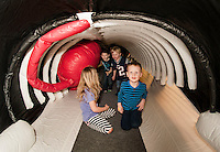 Sadie Harold, Carter Bullerwell, Aiden Vintenner and Baylor Harold get to walk inside the belly of a whale during Abby Gonberg's presentation with the Blue Ocean Society for Marine Conservation on Sunday afternoon at the Leavitt Park Clubhouse.  (Karen Bobotas/for the Laconia Daily Sun)