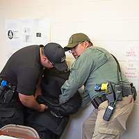 Gallup Police Officers John Gonzales, left, and Francis Collins, right, participate in training called Response to Resistance, Wednesday, August 28 by the Gallup Police Department. The officers participated in several scenarios of the reality based training.