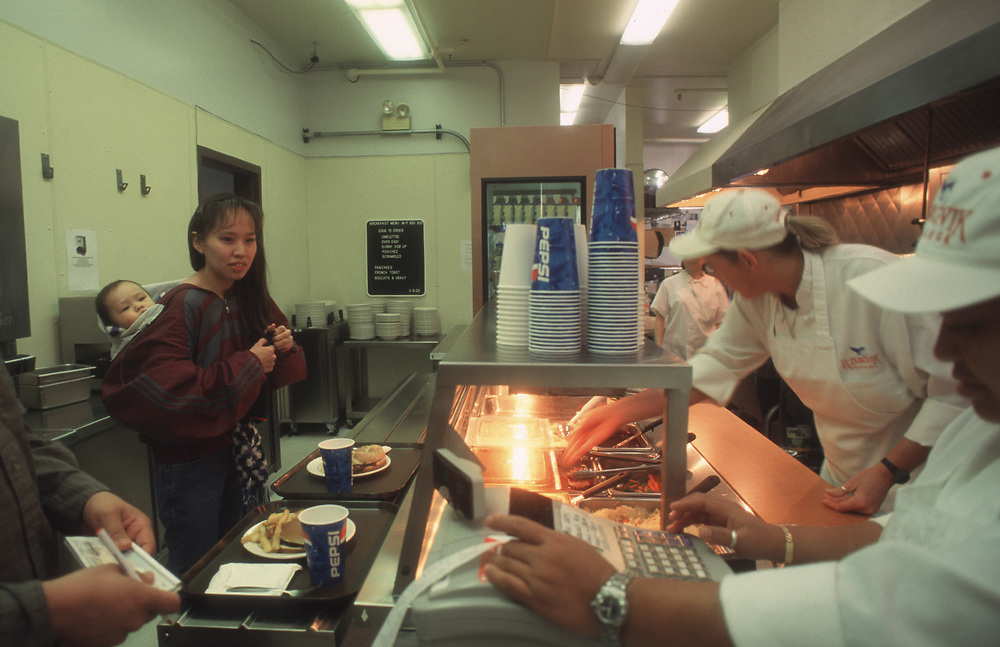 Lunchtime at Ilisagvik College cafeteria, the northermost place you can buy a bite to eat in America.<br /> From left to right: Bradley Weyiouanna, his wife Michelle and baby Esau, Wendy Johnston, pantry chef and Anabelle Alfaro, kitchen Manager at the cashier.<br /> <br /> May 15, 12:10
