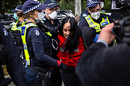 A woman is violently arrested for disobeying police outside of 120 Racecourse Road amid the third full day of the total lockdown of 9 housing commission high rise towers in North Melbourne and Flemington during COVID 19.After recording 191 COVID-19 cases overnight forcing Premier Daniel Andrews to announce today that all of metropolitan Melbourne along with one regional centre, Mitchell Shire will once more go back to stage three lockdowns from midnight Wednesday June 8. This comes as the residents of the housing commission towers in North Melbourne and Flemington finish their third day under extreme lockdown, despite only 27 cases being found in the towers. Members of the public gathered outside of the towers this afternoon in support of those trapped inside while riot police arrested two women for standing too close to the fence. While the women were later released, tensions are boiling over both in the towers and out. With 772 active cases in Victoria, NSW closed their border to Victoria effective at midnight tonight.