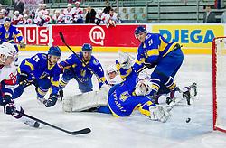 Robert Sabolic of Slovenia scores vs Igor Karpenko of Ukraine during ice-hockey match between Slovenia and Ukraine at IIHF World Championship DIV. I Group A Slovenia 2012, on April 19, 2012 in Arena Stozice, Ljubljana, Slovenia. Slovenia defeated Ukraine 3-2. (Photo by Vid Ponikvar / Sportida.com)