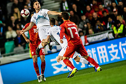Andraž Šporar of Slovenia vs Enis Bardi of Macedonia and Boban Nikolov of Macedonia during football match between National teams of Slovenia and North Macedonia in Group G of UEFA Euro 2020 qualifications, on March 24, 2019 in SRC Stozice, Ljubljana, Slovenia.  Photo by Matic Ritonja / Sportida