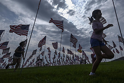 September 10, 2017 - Los Angeles, California, U.S - People run amongst 3,000 of US flags at Pepperdine University to mark the 16th anniversary of the 9/11 terror attack, September 10, 2017 in Malibu, California. (Credit Image: © Ringo Chiu via ZUMA Wire)
