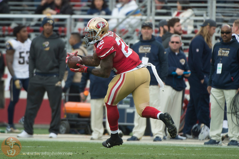 January 3, 2016; Santa Clara, CA, USA; San Francisco 49ers running back Mike Davis (22) catches the football during the second quarter against the St. Louis Rams at Levi's Stadium. The 49ers defeated the Rams 19-16.