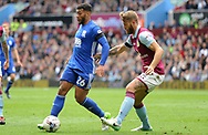David Davis of Birmingham battles with Nathan Baker of Aston Villa ®.  EFL Skybet championship match, Aston Villa v Birmingham city at Villa Park in Birmingham, The Midlands on Sunday 23rd April 2017.<br /> pic by Bradley Collyer, Andrew Orchard sports photography.