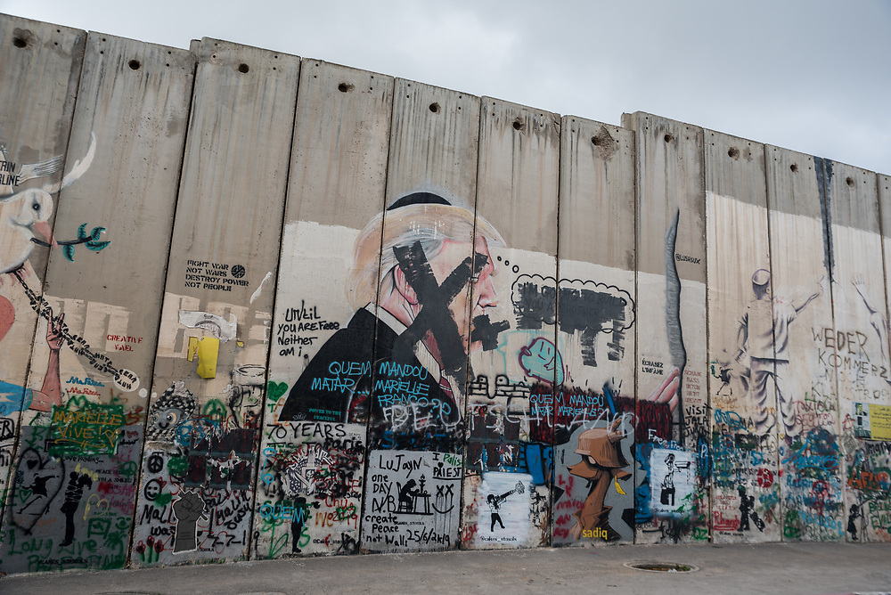 1 March 2020, Bethlehem: A painting of United States president Donald Trump, with his face and mouth 'silenced', decorates the separation wall that runs through Bethlehem.