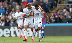 Bournemouth's Jordon Ibe celebrates with team mate Steve Cook after he scores to make it 3-2 during the Premier League match at Selhurst Park, London.
