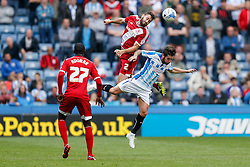 Damia of Middlesbrough and Jacob Butterfield of Huddersfield compete in the air - Photo mandatory by-line: Rogan Thomson/JMP - 07966 386802 - 13/09/2014 - SPORT - FOOTBALL - Huddersfield, England - The John Smith's Stadium - Huddersfield town v Middlesbrough - Sky Bet Championship.