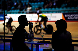 Fans have a drink as the Men's Madison Chase goes by during day one of the Six Day Series Manchester at the HSBC UK National Cycling Centre.
