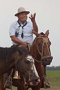 A gaucho man on horseback, at a Gaucho Estancia In Lujan, Argentina.