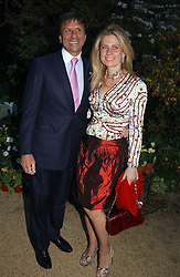 The HON.SIR ROCCO & LADY FORTE at the Cartier Chelsea Flower Show dinat the annual Cartier Flower Show Diner held at The Physics Garden, Chelsea, London on 23rd May 2005.<br />