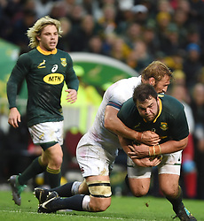 Cape Town-180623- Springbok player Frans Malherbe tackled by Bred Shields of England  in the last game of the Castle Lager Test between Springboks and England at Newlands Stadium photographer:Phando Jikelo/African News Agency/ANA