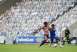 Kwame Poku of Colchester United and Sido Jombati of Oldham Athletic tussle for the ball - Mandatory by-line: Arron Gent/JMP - 03/10/2020 - FOOTBALL - JobServe Community Stadium - Colchester, England - Colchester United v Oldham Athletic - Sky Bet League Two