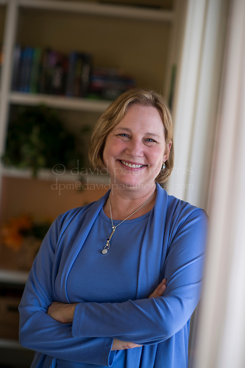 Author Katherine Applegate poses for a photograph in her home in Tiburon, California, U.S., on Monday, Feb. 4, 2013. Her 2012 novel 'The One and Only Ivan' is the recipient of the 2013 Newbery Medal. Photographer: David Paul Morris