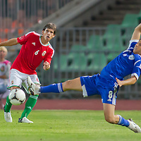 Hungary's Zsolt Laczko (L) and Israel's Maor Melicsohn (R) fight for the ball during a friendly football match Hungary playing against Israel in Budapest, Hungary on August 15, 2012. ATTILA VOLGYI
