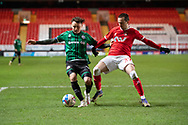 Rochdale's Ollie Rathbone and Charlton's Liam Millar during the EFL Sky Bet League 1 match between Charlton Athletic and Rochdale at The Valley, London, England on 12 January 2021.