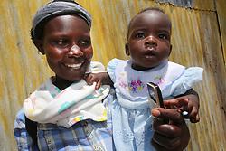 Magret Aking Odera and baby. MMS ANC outreach Clinic. SAHFA baseline survey visit to Angiya, Homa Bay County, Kenya.  SAHFA Kenya © April 2019