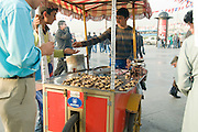 Turkey, Istanbul, The Spice Bazaar a mobile stall selling hot Chestnuts