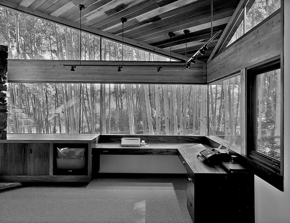 An addition to a home on Wilson Mesa, outside of Telluride. This private office was entered via a small door in the master closet, top secret. I cantilevered the office out into the aspen grove, with mitered glass to bring the trees into the room. I was responsible for all aspects of the Design, Construction Documents and Administration.
