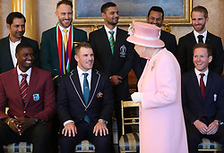 Queen Elizabeth II joins the captains of the teams taking part in the ICC Cricket World Cup for a photograph in the 1844 Room at Buckingham Palace in London, ahead of the competition's Opening Party on the Mall. Back row, from left: Sarfaraz Ahmed (Pakistan), Francois du Plessis (South Africa), Masrafe Bin Mortaza (Bangladesh), Dimuth Karunaratne (Sri Lanka), Kane Williamson (New Zealand). Front, from left: Jason Holder (West Indies), Aaron Finch (Australia), Queen Elizabeth II, Eoin Morgan (England).