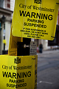 Parking suspended warning signs. Central London