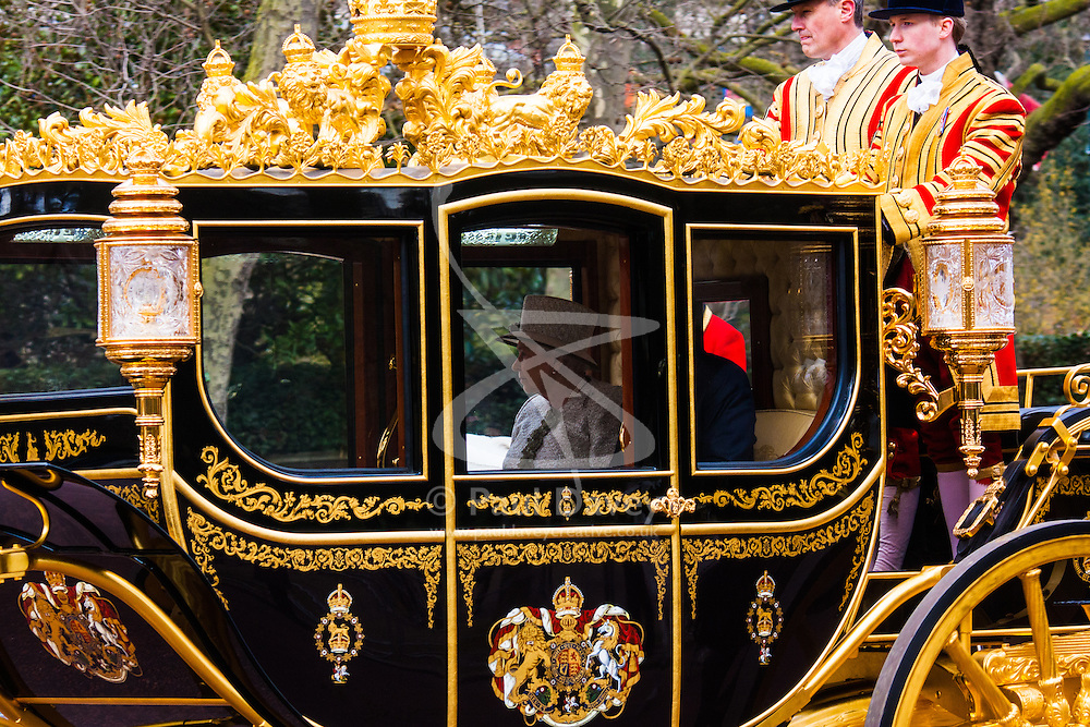 London, March 3rd 2015. Mexican President Enrique Pena Nieto travels with Her Majesty The Queen and other members of the Royal Family by State Carriage along the Mall towards a luncheon at Buckingham Palace after a ceremonial welcome at Horseguards Parade. PICTURED: Her Majesty the Queen, Elizabeth II travels with Mexican President Enrique Pena Nieto in the State Carriage. PICTURED: Her Majesty the Queen, Elizabeth II travels with Mexican President Enrique Pena Nieto in the State Carriage.
