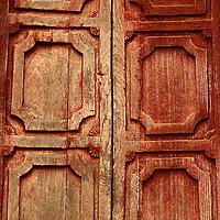 Wood door of monastery at Nyaubgshwe