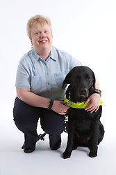 Blind woman with her guide dog,