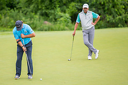 June 22, 2018 - Madison, WI, U.S. - MADISON, WI - JUNE 22: Scott McCarron putts on the eighth hole while Jerry Smith looks on during the American Family Insurance Championship Champions Tour golf tournament on June 22, 2018 at University Ridge Golf Course in Madison, WI. (Photo by Lawrence Iles/Icon Sportswire) (Credit Image: © Lawrence Iles/Icon SMI via ZUMA Press)