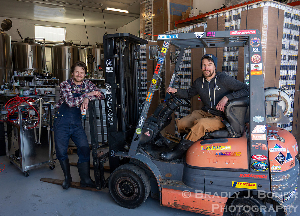 """Highpoint Cider co-founders Andrew and Alex Perez pose with their fork lift named """"MAC"""" after their grandmother, Mary Ann Crisp, as a hat-tip to their family's New England roots and work ethic."""