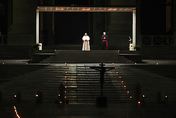 Pope Francis celebrates the solemn Via Crucis in an empty St. Peter's Square due to the restrictions for Covid 19 emergency, in Vatican City, Italy, on April 10, 2020. Photo by Piero Tenagli / IPA/ABACAPRESS.COM