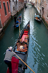 Gondolas on small canal in Venice Italy