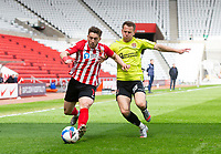 Football - 2020 / 2021 Sky Bet League One - Sunderland vs Northampton Town - Stadium of Light<br /> <br /> Lynden Gooch of Sunderland vies with Bryn Morris of Northampton Town<br /> <br /> Credit : COLORSPORT/BRUCE WHITE