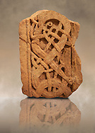 Anglo Saxon sandstone cross shaft fragment, 775-840. The complicated pattern depicts ribbon shaped animals with long thin bodies and legs. An animals face can be seen in the bottom right in profile with one eye and a mouth .Lindisfarne Abbey Museum, Northumbria, England .<br /> <br /> Visit our MEDIEVAL ART PHOTO COLLECTIONS for more   photos  to download or buy as prints https://funkystock.photoshelter.com/gallery-collection/Medieval-Middle-Ages-Art-Artefacts-Antiquities-Pictures-Images-of/C0000YpKXiAHnG2k
