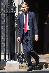 London, July 30th 2014. Foreighn Secretary Philip Hammond leaves 10 Downing Street having chaired a meeting of the COBRA committee to discuss the threat to Britain of the outbreak of Ebola virus in West Africa.