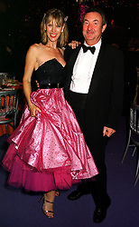 MR & MRS NICK MASON he is a member of rock group Pink Floyd, at a ball in West Sussex on 18th September 1999.MWL 46