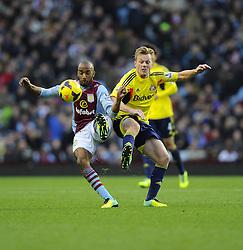 Aston Villa's Fabian Delph is fouled by Sunderland's Sebastian Larsson - Photo mandatory by-line: Joe Meredith/JMP - Tel: Mobile: 07966 386802 30/11/2013 - SPORT - Football - Birmingham - Villa Park - Aston Villa v Sunderland - Barclays Premier League