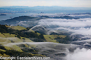 aerial photograph San Francisco skyline from the Marin Headlands as the fog rolls in
