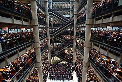 Staff line the atrium during the Lloyd's of London Armistice commemoration service.