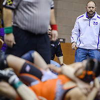Miyamura wrestling coach Ken Starkovich watches a match from the edge of the mat during a district meet at Gallup High School Saturday.
