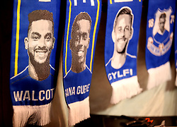 Everton scarves bearing the faces of Theo Walcott, Idrissa Gueye and Gylfi Sigurdsson for sale before the Premier League match at Goodison Park, Liverpool.