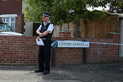© Licensed to London News Pictures. 17/07/2020. London, UK. A police officer on Lytton Avenue, Enfield, in north London as police launch a murder investigation following the death of a man in his 30s. Police were called at 04:45hrs early this morning, to a report of four men fighting in Lytton Avenue, Enfield and a man being put into a vehicle. Later the victim died from a single stab wound in North Middlesex Hospital. Three men, no further details, have been arrested on suspicion of murder; all remain in custody. Photo credit: Dinendra Haria/LNP