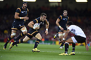 Gareth Davies of Wales makes a break. Rugby World Cup 2015 pool A match, Wales v Fiji at the Millennium Stadium in Cardiff, South Wales  on Thursday 1st October 2015.<br /> pic by  Andrew Orchard, Andrew Orchard sports photography.