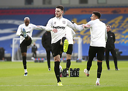 West Ham United's Declan Rice and Jesse Lingard warming up prior to kick-off during the Premier League match at the American Express Community Stadium, Brighton. Picture date: Saturday May 15, 2021.