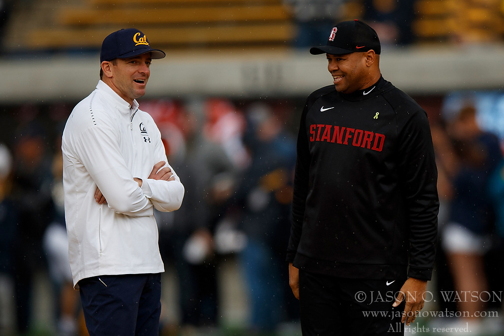 BERKELEY, CA - DECEMBER 01:  Head coach Justin Wilcox of the California Golden Bears talks to head coach David Shaw of the Stanford Cardinal before the game at California Memorial Stadium on December 1, 2018 in Berkeley, California. The Stanford Cardinal defeated the California Golden Bears 23-13. (Photo by Jason O. Watson/Getty Images) *** Local Caption *** Justin Wilcox; David Shaw