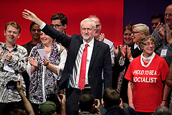 © Licensed to London News Pictures. 28/09/2016. Liverpool, UK. JEREMY CORBYN singing red flag on stage with his supporters after delivering his leaders speech at day four of the Labour Party Annual Conference, held at the ACC in Liverpool, Merseyside, UK. Photo credit: Ben Cawthra/LNP